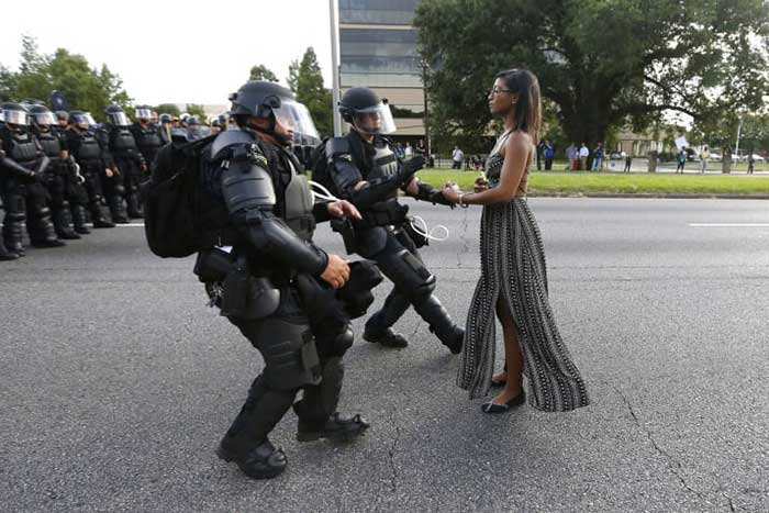 Here's an iconic image from that march that features their activist Leshia Evans
